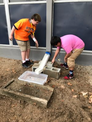 Nimitiz Middle School students investigating water run-off issues on their campus.
