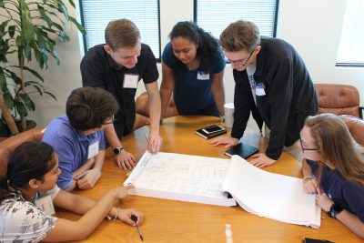 green building interns reviewing BLGY site plans for blazier intermediate school in Austin ISD